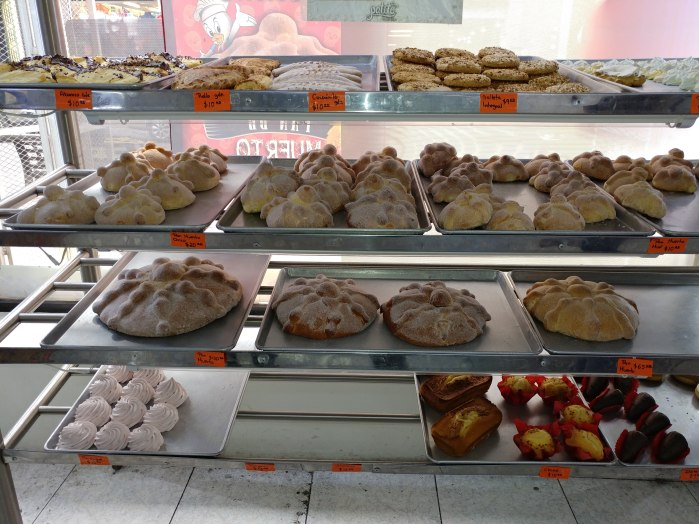 Pan de Muerto at El Patito Pasteleria. Small, medium, large, and extra large sizes! Photo by Angela Grier