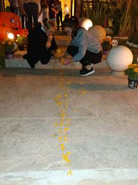Spreading the petals to guide the spirits. Photo by Angela Grier
