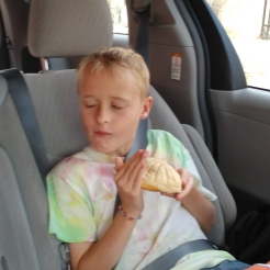 Enjoying a sweet roll on the way home. Photo by Angela Grier