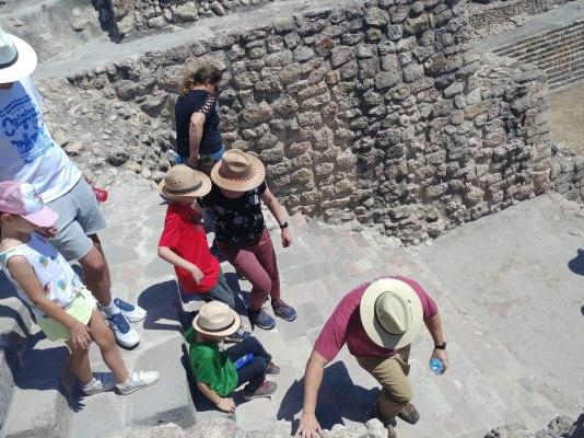 Climbing down the steep steps of the Cañada de la Virgen pyramid. Photo by Angela Grier